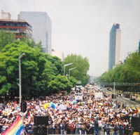Photo: Marchers in the XXVI Marcha Del Orgullo LGBT (26th March of GLBT Pride) start at the Ángel de la Independencia (The Angel of Independence), in Mexico City, Mexico. June 26, 2004. Photo Credit: Bradford McIntyre