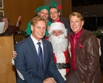Bradford McIntyre (Right) & partner Deni Daviau (Left) on Santa's lap at the Positive Living BC Members Holiday Season Dinner 2013.