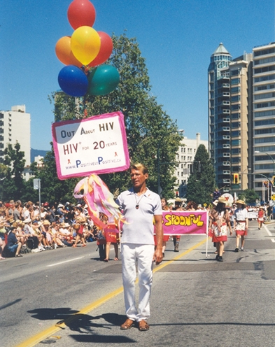 Bradford McIntyre, HIV+ since 1984, marches in the Vancouver PRIDE Parade 2004, holding his homemade sign: HIV+ for 20 years.