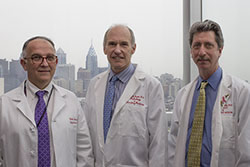 Photo: University of Pennsylvania Perelman School of Medicine researchers, L-R, Pablo Tebas, MD, Carl June, MD and Bruce Levine, PhD