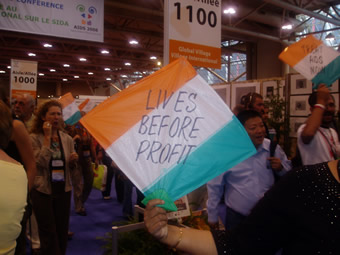 AIDS 2006: Treatment activists carry flags that read: LIVES BEFORE PROFIT.